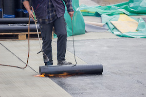 How to Decide Between Hot Tar Roof Repair and Replacement